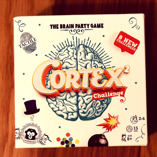 Cortex box, is white with Organge writing,  the brain party games with 8 new challenges